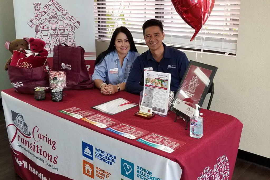Caring Transitions Couple at Trade Show