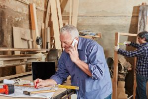 Handyman talking to support