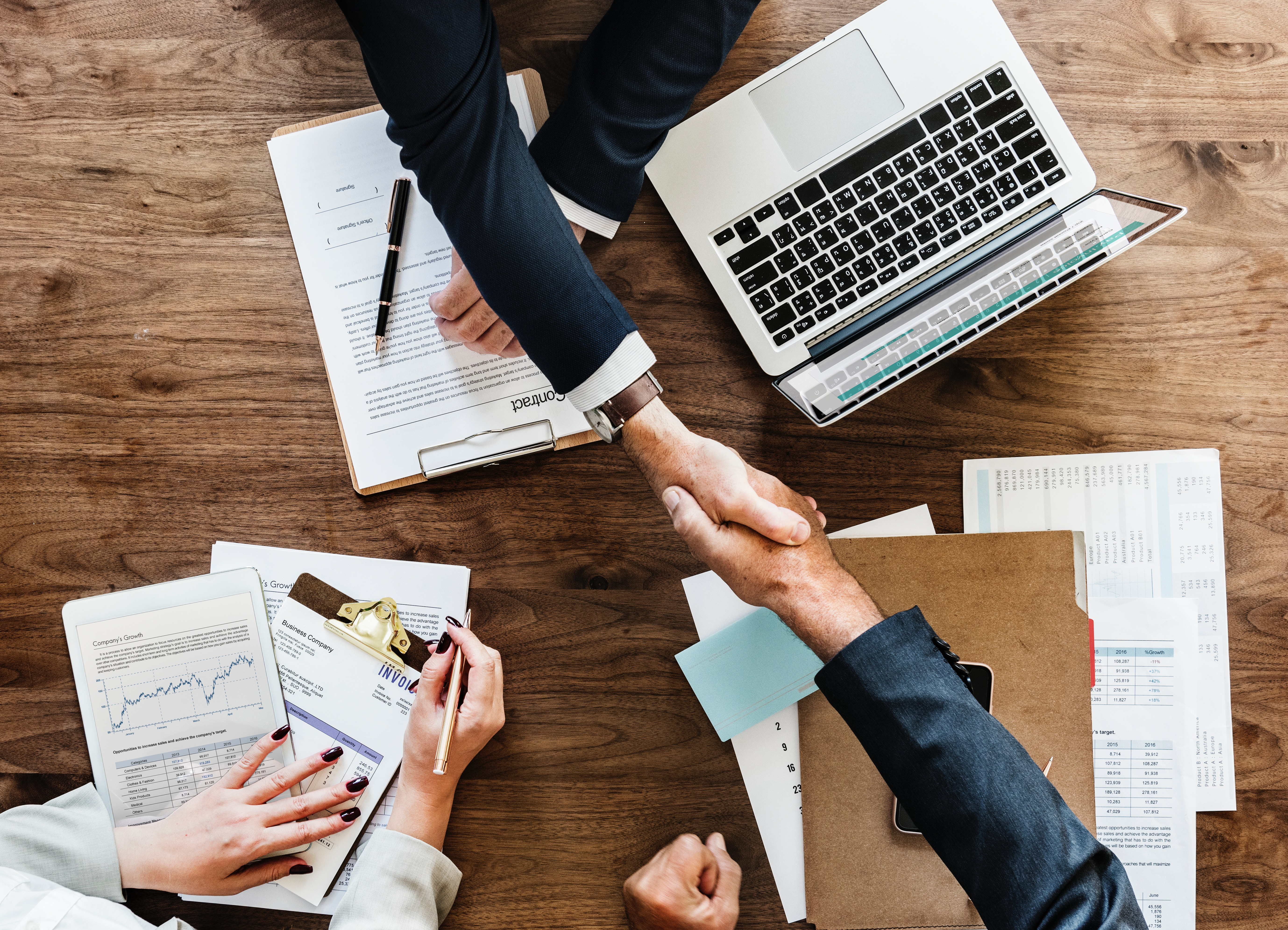 Business Plan and Businessmen shaking Hands